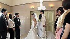Slutty Japanese bride in lingerie indulges in wild group sex