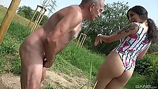 Provocative slut drops on her knees to suck an older man\'s dick